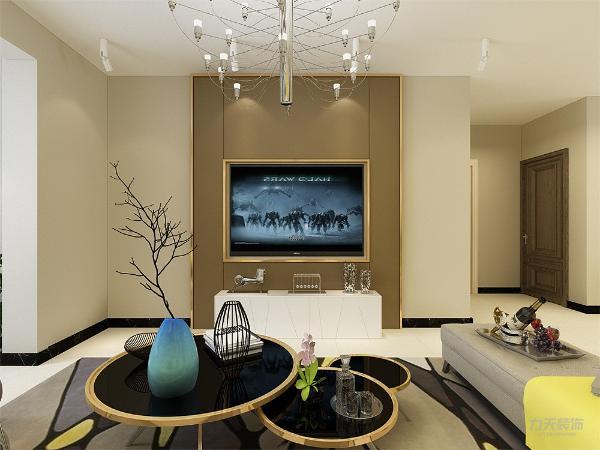 电视背景墙做了简单的造型,色调为暗色,既简单又大方