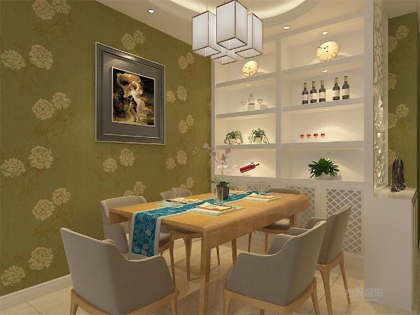 餐厅用暖绿色花纹壁纸,区别与客厅,温馨中多了一份清爽。客厅为回字型吊顶,餐厅为椭圆形吊顶,与壁纸相呼应,使空间很简洁、大方,又分区明确,富有节奏韵律。