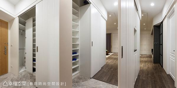 玄关以大理石地坪与室内区隔,并规划大型衣鞋间满足全家人的收纳需求。