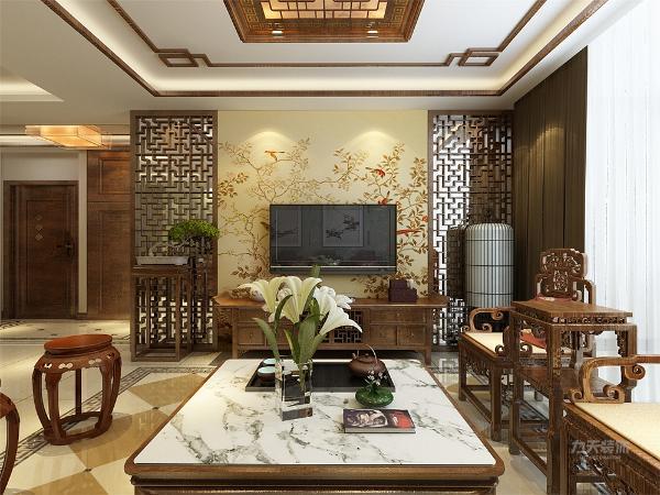 电视背景墙同样是采用中国花样的电视柜和背景造型,整个空间相呼应,相互协调。