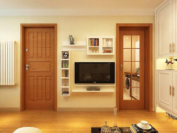 客厅的面积较小,放的是两人座沙发,为了节省空间,在客厅摆放了一个较小的茶几,电视背景墙也很短,就在电视背景墙上放了有储物功能的格子,这样既有美观效果,也起到了储物功能。
