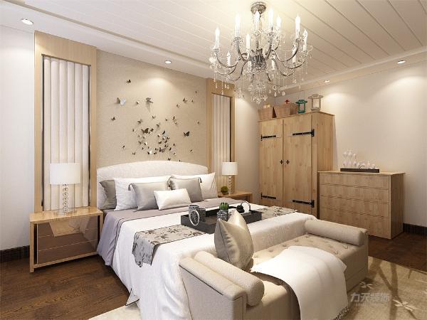 在卧室里放置了一个大衣柜,方便了业主起居的穿戴。整体采用的现代简约的设计风格,更加凸显整体的设计风格。