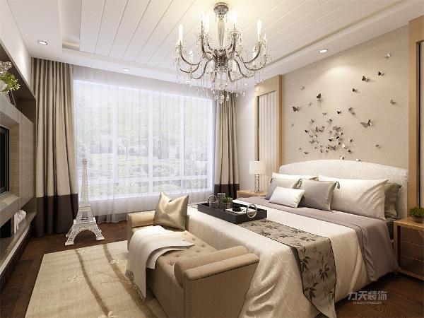 主卧与客厅挨着,偌大的落地窗,使整个房间看起来明亮大方,同时在卧室中增加了一个埃菲尔塔,为卧室增加了一些浪漫的气氛,床头背景墙增加了翩翩起舞的蝴蝶做点缀,与埃菲尔铁塔相互辉映,更加增加了浪漫的氛围。