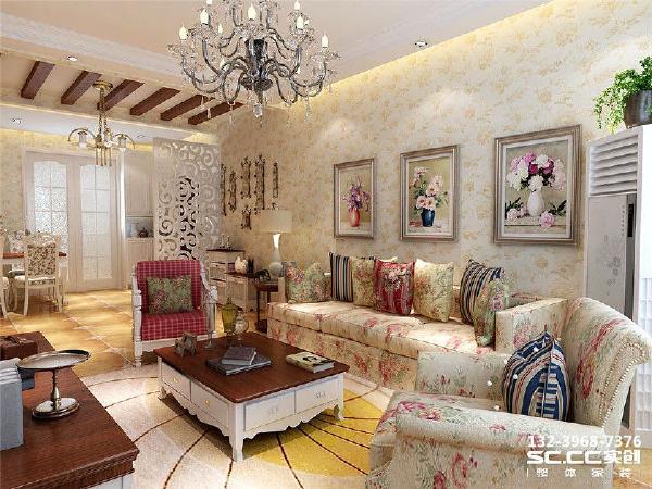 """温暖的黄色作为整个客厅的主色调,沙发上开出朵朵花朵,拥簇在一起,和背景墙上的花朵相呼应。电视墙很简单,只是""""绘""""出简单的线条,旁边设计了一些置物架,摆放上一些可爱的装饰品就足以让这个客厅无边幸福。"""