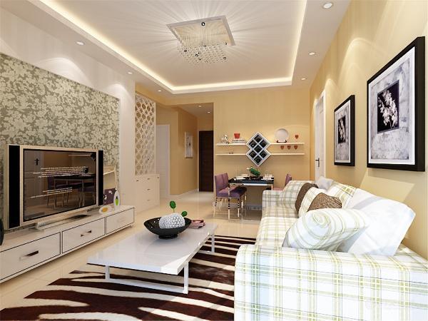 墙面用富有美感的储物架来装饰。电视背景墙用一圈石膏板圈边,内嵌绿色花纹壁纸,与整个空间很搭配。地面采用米黄色地砖,使整个空间更为温馨。