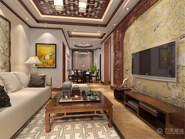 客厅电视背景墙,采用实木镂空雕花板的样式,吊顶采用方格型雕花板;整体客餐厅都用木色材质,体现了中式的这种的古色。