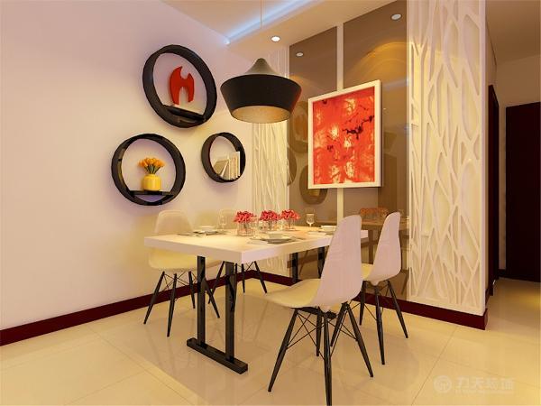 餐厅的灯与餐桌均满足了现代简约风格的要求,造型简约却十分时尚。红色图案的油画更是为烘托气氛起到了画龙点睛的作用。