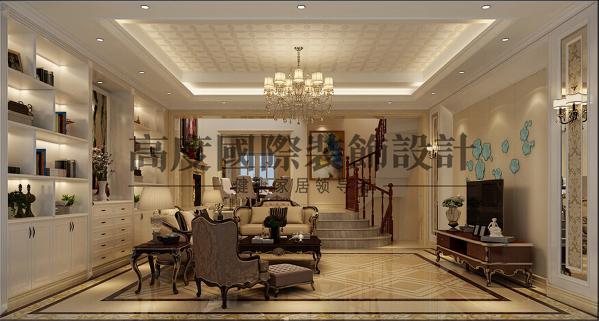 客厅顶面和地面的地砖拼花相呼应,整排的书柜为空间增添书香气息,米黄色调的空间简约大气。低调奢华的客厅设计