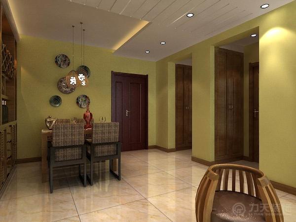 餐桌区域设计了酒柜,这样及多了储物空间,又增加了主人的生活品味。餐桌靠着酒柜竖放,这样既不影响走到又美观上菜也方便。餐桌的材质使用的实木和藤条相结合体现了东南亚风格的追求自然的特点。