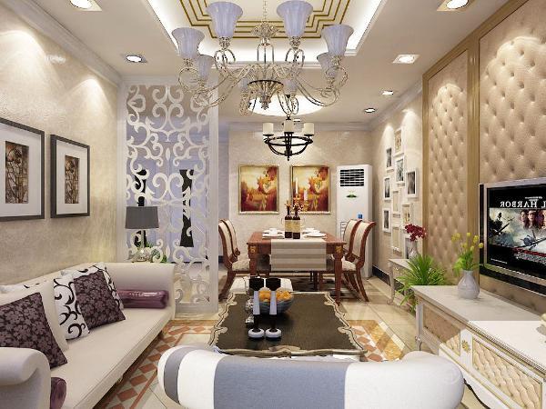 电视背景后面专门制作了拉丝皮包,不是太单调,沙发背景是三幅抽象画,简单不高调,客厅主灯是是客厅的重心,传统欧式吊灯显得大气高贵。