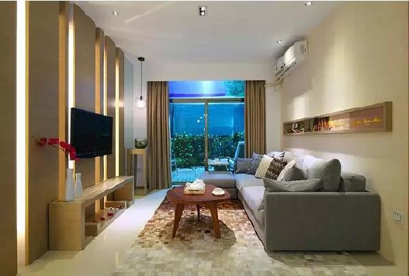电视背景墙用木饰面打造,隐藏的灯带时尚又动感,让身心栖息在自然的木  香之中。