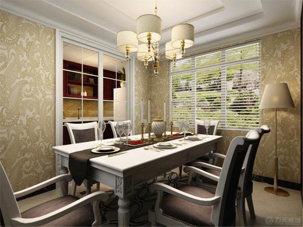 餐厅与厨房的设计既一脉想成,又相互分离,餐厅的颜色与厨房的色彩形成了鲜明的对比,简洁的餐桌以及橱柜相结合形成鲜明的对比餐厅的吊顶同样设置成2级吊顶,一盏吊灯相配合。