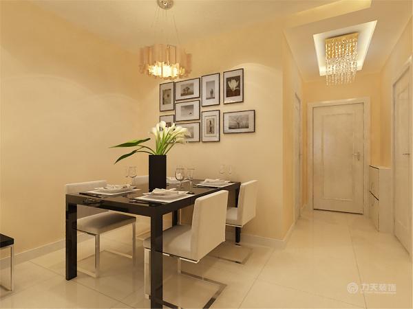 在餐厅灯的选择上沿袭了现代感十足的的吊灯。餐桌椅的选择为了统一和客厅的沙发选择的是一样的材质,在颜色的选择上也是很淳朴的,给人一种简单舒适的感觉。餐厅背景则选择了挂画来增加空间的色彩。