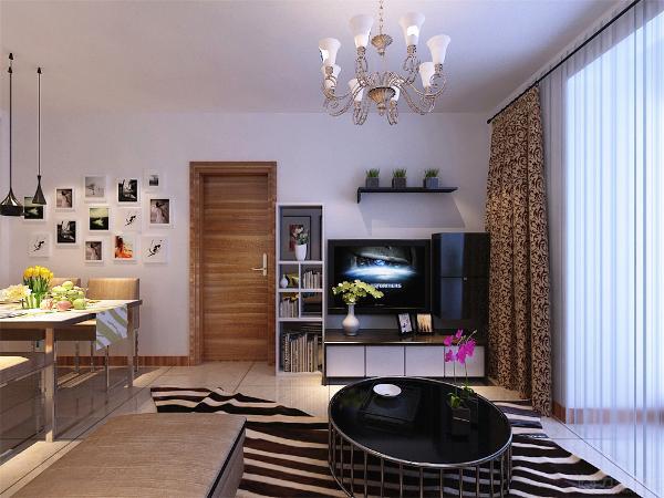 客厅的电视背景墙是以一套组合柜子做了一个简单而又美观的造型,墙体图片