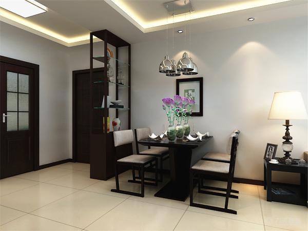 餐厅与客厅呼应,采用统一色调,家具造型简单且美观。顶上的小吊灯极具富有现代气息,沉稳中增加趣味性。