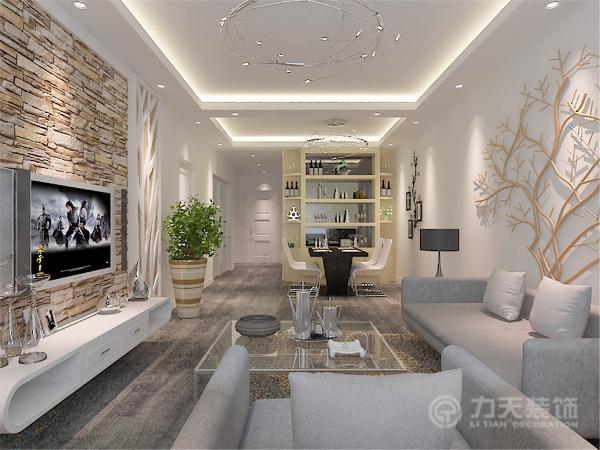 """多处造型运用形似或者神似""""树""""的造型来充实屋内的风格。客厅的电视背景墙采用了文化史的铺贴,增加了居室的现代元素。而沙发的背景墙则是一棵树的木造型。"""