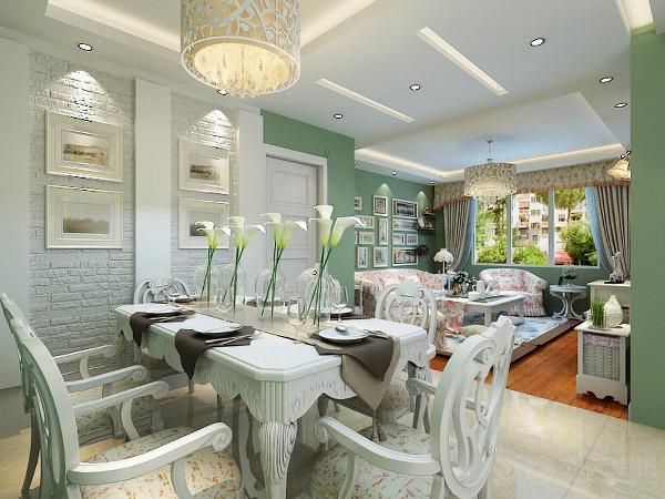 客厅的墙用了淡绿色,沙发和窗帘用了大量的小碎花。布料来点缀。使整体感更活跃。地面用原木色地板。沙发背景墙用装饰画组合,更贴近生活。