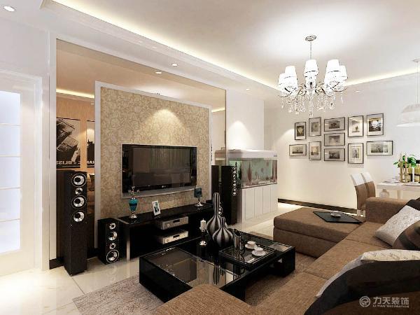 电视柜是以不锈钢和镜子组成,显的整个空间比较亮堂。沙发背景墙是以画为主,整个空间的软装都是以咖色为主,吊顶则是简单的回字形吊顶,彰显了极简主义的特点