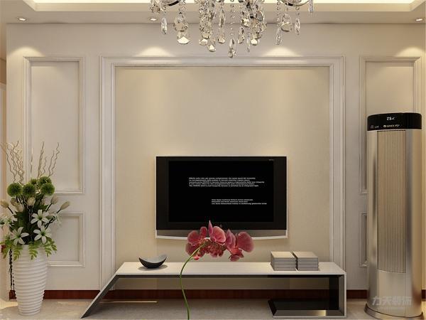 电视背景墙使用石膏板造型,在石膏板基础上使用混油材质,使背景墙简单而又上档次,沙发背景墙无过多装饰,使用简单的挂画装饰墙面。