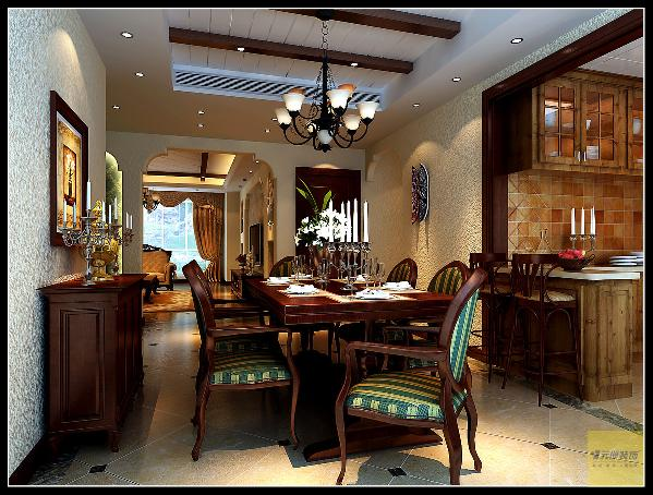 餐桌和开放式的西厨的橱柜,从颜色到造型都非常的协调统一。
