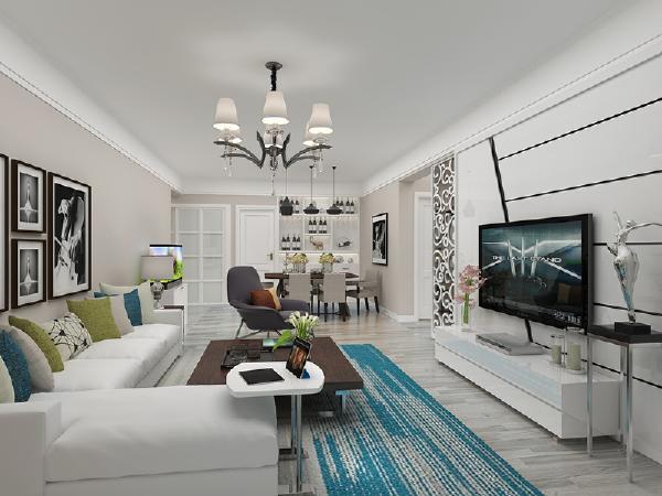 客厅 挂镜线造型拉伸空间高度,吊顶造型=没有造型,使空间统一起来,又有自己的个性。软装上以湖蓝色和青草绿来调节色彩,灰色地板冷静简洁。