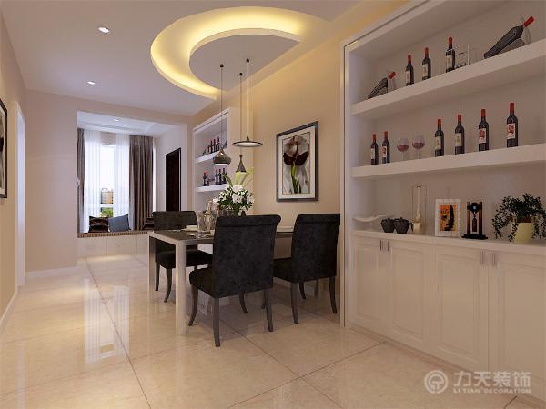 餐厅区域与客厅区域紧密相连,吊顶采用半弧形发光灯池吊顶,十分美观,餐桌两边分别摆放现代的酒柜及中间搭配简单的挂画,时尚,又惬意,给整个空间增添了一丝活跃感。