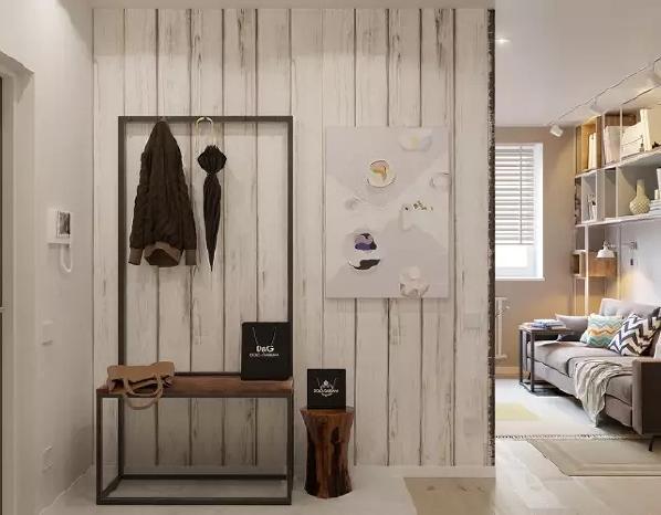 一进门就感受到了房间的简约工业风,玄关处的金属置物架很有范儿,带着木纹的白色木板墙饰与原木墩换鞋凳都充满了原生态的味道。