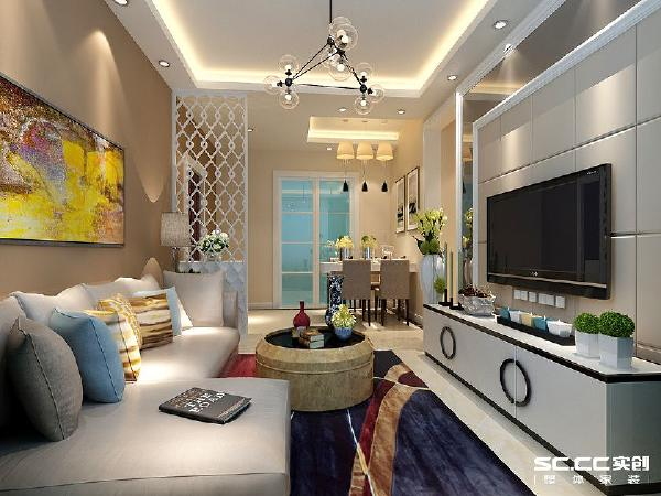 餐厅和客厅是在一个空间,为了能很好的区分空间局部采用了吊顶划分,在这基础上加点人工光源,整个空层次感厨房的门用推拉门。