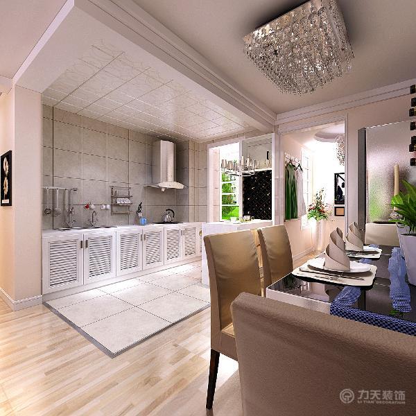 厨房采用白色钢琴烤漆的材质。在厨房的位置还设有一个吧台,方便做饭。给人现代感,整洁和舒适。