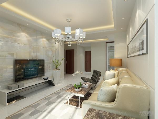 客厅我们在设计上选择了背景墙用大理石石材, 地砖的采用使得材质更加丰富, 使用了白色皮质沙发与咖色大理石茶几搭配, 在配色上显得更加大方华贵。