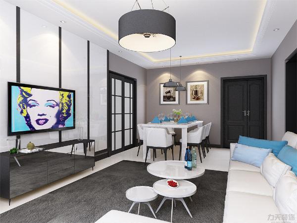 客厅电视背景墙运用黑白双色的结合,增加了空间对比性,增加光线感,使空间严肃整洁,其他墙面通刷卡其色乳胶漆。给人一种厚重感。沙发背景墙加入了多层矩形镜面装饰,简单大方,突出了客厅的空间感与艺术感。