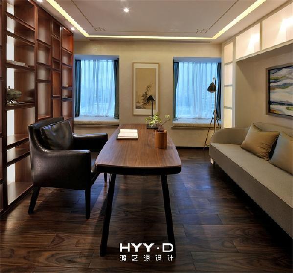 """书房 传统元素与现代材质的搭配,将经典提炼并加以丰富,打造一个可以""""调素琴,阅金经,无案牍之劳形""""的精神空间。"""