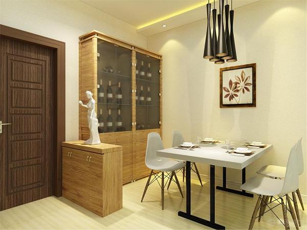 入户门位置旁边摆放一个矮柜,和一个磨砂玻璃的酒柜搭配现代家居的吊灯和餐桌。