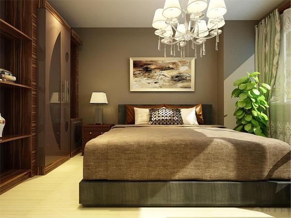 主卧空间是休息区域,所以要在简单中突显美观和稳重,采选的色调是深棕灰色和绿植的结合。