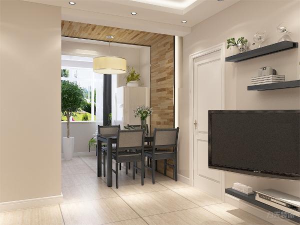餐厅区域的设计是,采用墙面与吊顶相连的木质铺装,具有现代的气息,餐桌采用的是黑色镜面桌,黑色座椅,冰箱也被放在这位置,充分得到利用。