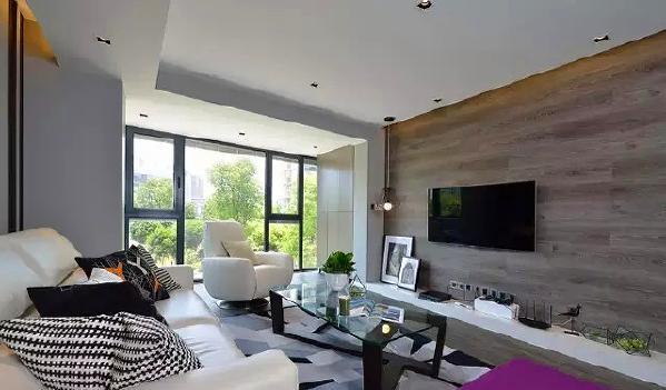 ▲ 灰色作为主色调,控制整个空间氛围,地板上墙工艺作为电视背景墙