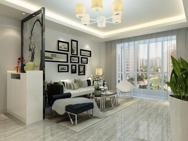 我的设计风格是简约风格,我们首先看客厅,客厅采用回字形吊顶加灯带装饰中间是吊灯。