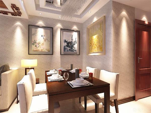 餐桌的墙上刷白色乳胶漆,外面包裹一层花纹壁纸,显得屋内气氛更有温馨。