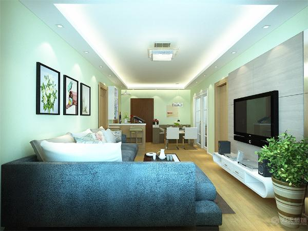 客厅设计采用简约明朗的线条,将空间进行了合理的分隔。整体颜色以简洁的淡绿色为背景,只有茶几几个大件是深色的,在客厅里做一个色彩对比,现出现代简约的格调。