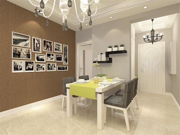 餐厅区,餐桌为灰白色调。照片墙为白色边框,简洁的黑白照片凸显出了业主的个性。