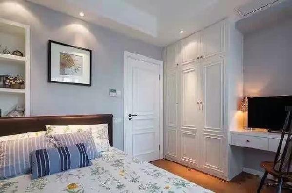 灰色的墙面让人感觉平静,舒适,搭配弧形的家具,给人充实感