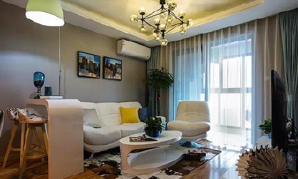 灰色的墙面让人感觉安静、舒缓,搭配弧形的家具,给人充实感。