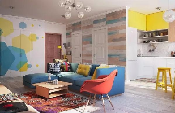 开门进屋,被客厅明艳缤纷的色彩吸引 柔软的蓝色沙发,色彩丰富的抱枕, 正红色单人椅,柠檬黄色台灯与圆凳、手工编织地毯…… 这些大胆又丰富的配色,带来满满的活力。