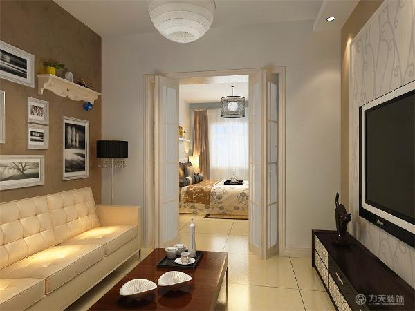 沙发旁放灯,另一边墙上放暖气片,电视背景墙外面采用深咖色乳胶漆,石膏板圈边,里面用浅色壁纸,电视采用壁挂式。