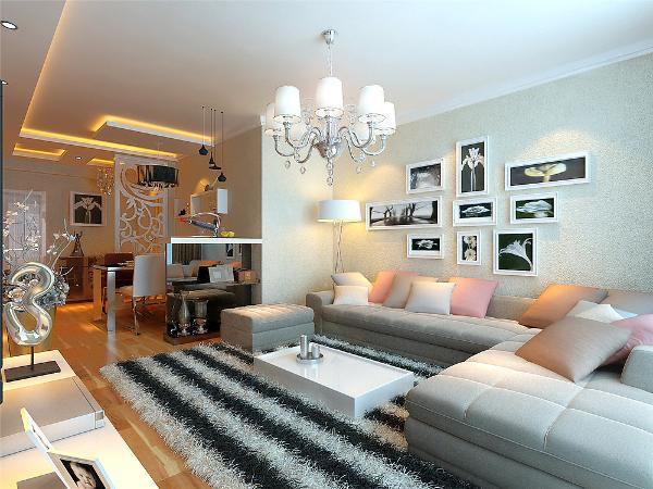 客厅的整体色系为暖色系,电视背景上方做直线边棚,用点光源照耀整体艺术的硅藻泥墙面。