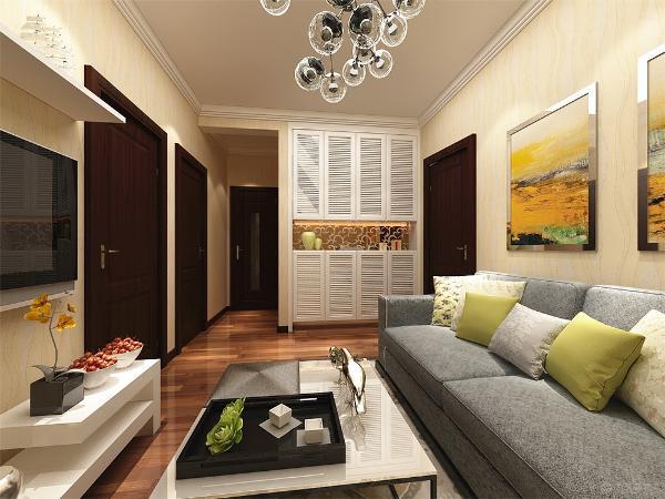 首先客厅选择了暖色的壁纸显得特别温馨搭配布艺的沙发和简单的墙体装饰 使整个空间简单而又不失温馨,