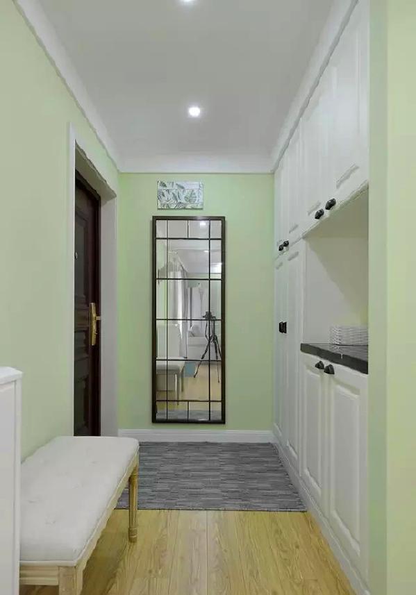 ▲ 入门玄关处,白色收纳柜提供充足的空间,格纹穿衣镜非常实用