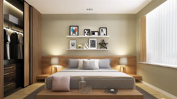 空间被粉刷了灰绿色,在木质家具的衬托下拼凑出一个有效化的空间,不仅减缓了灰色床品的幽暗,也增加了空间中的温润,让生活愈加舒适。