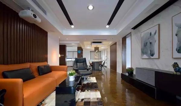 ▲简洁大气的地面采用艺术地坪漆处理,搭配黑白泼墨风图案的地毯