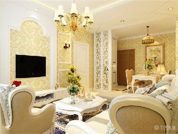 客厅的电视背景墙采用业主要求样式制作,大芯板沉底,外面做白色混油。客厅与餐厅相间的顶面做样条拉缝处理,美观又时尚。